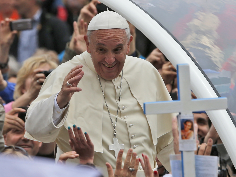 Pope Francis waves to the faithful as he is driven through the crowd after presiding over a solemn ceremony in St. Peter's Square at the Vatican on Sunday. He plans to convene an 'extraordinary' synod of bishops to review and debate teachings.