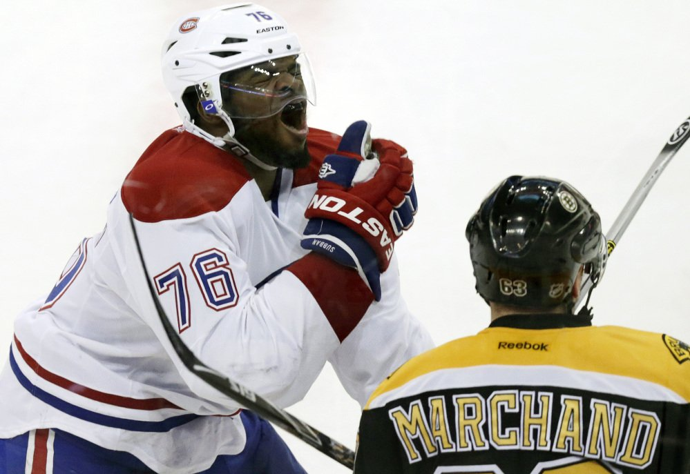 Montreal Canadiens defenseman P.K. Subban reacts after getting hit in the face by Boston Bruins left wing Brad Marchand's stick during Game 1 of their second-round Stanley Cup playoff series Thursday.