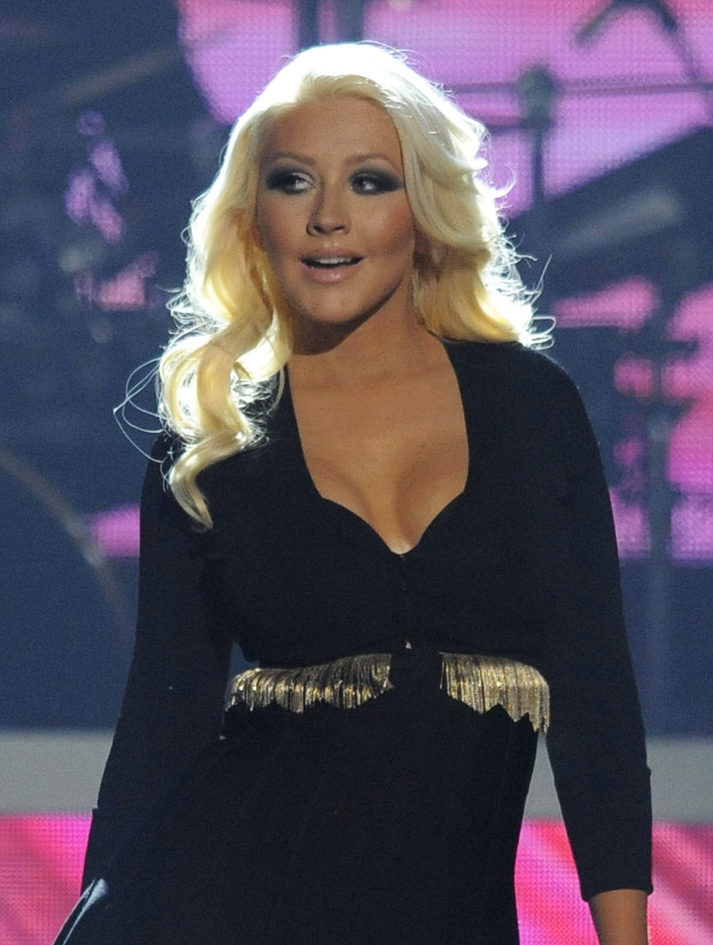 """Christina Aguilera, who is pregnant, says, """"It's Mama's job. We roll with it,"""" referring to her unborn daughter."""