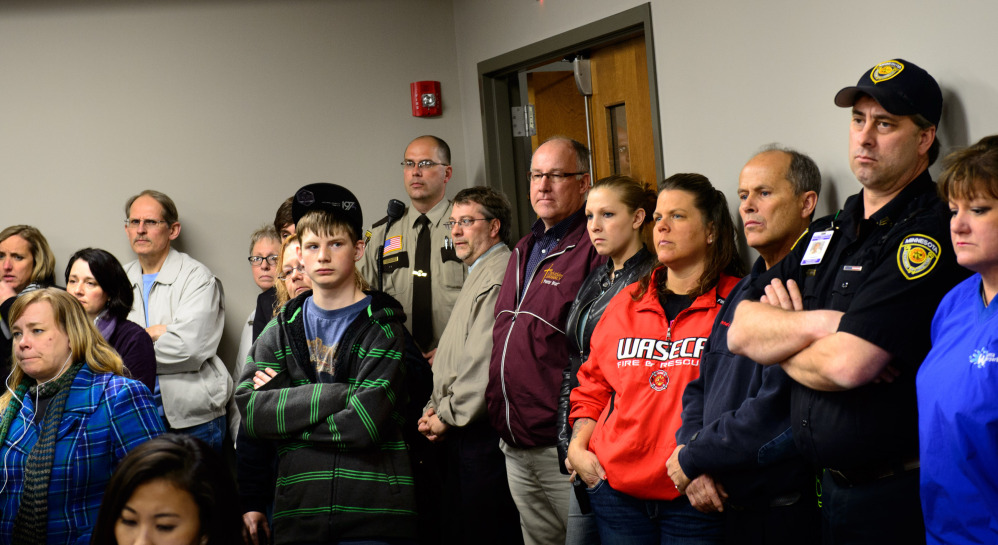 Students, parents and community members listen as Waseca Police Capt. Kris Markeson and Waseca school Superintendent Tom Lee speak about the 17-year-old arrested in a plot to kill his family and massacre students.