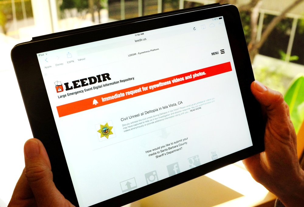 A computer tablet displays a website for LEEDIR, or the Large Emergency Event Digital Information Repository, that aims to make use of a document-everything culture evident on Instagram, Facebook and other social media to benefit law enforcement nationwide.