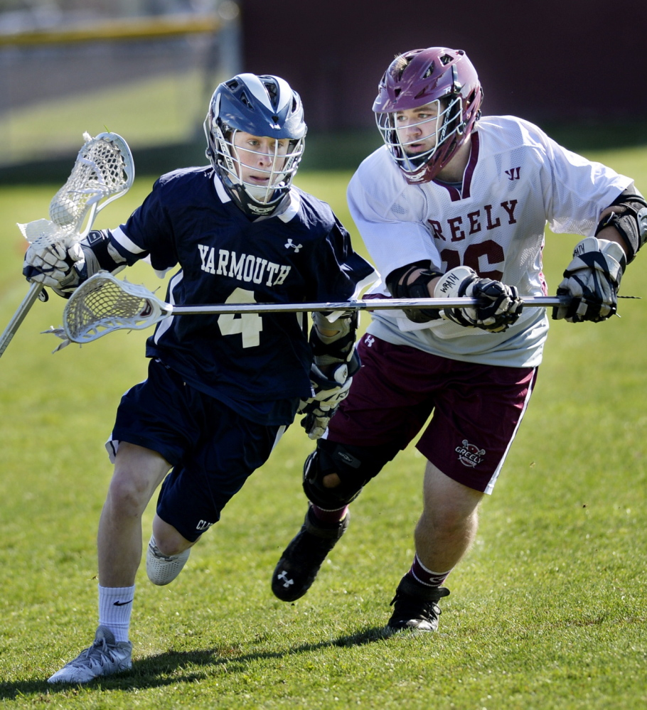 Patrick Grant of Yarmouth runs up the field with the ball Friday while being defended by Ryan Pomeroy of Greely during Yarmouth's 9-5 victory in a boys' lacrosse game at Cumberland.