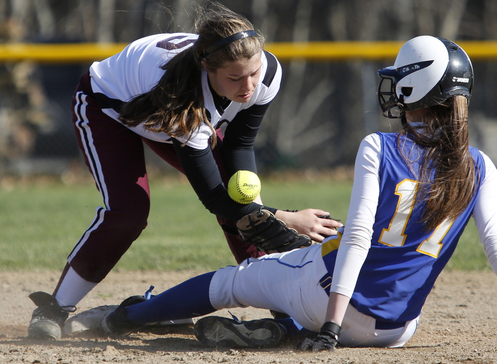 Bailey Karnes of Freeport attempts to control the ball Friday as Amanda Carver of Falmouth slides safely into second base during Falmouth's 17-0 victory in softball.