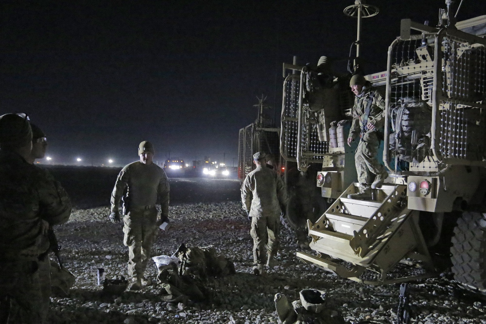 Members of the Convoy Escort Team of the 133rd Engineer Battalion of the Maine Army National Guard prepare to leave Bagram Air Field on Dec. 20 and head to Shank Forward Operating Base, roughly 80 miles to the south.