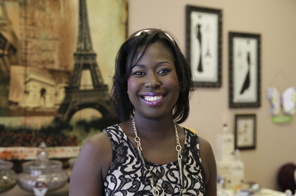 Psyche Terry, owner of Urban Intimates, poses for a photo at Indulge Your Senses boutique in Little Elm, Texas. She took part in The Workshop at Macy's, a training program that teaches women and minority entrepreneurs how to get their products into major stores.