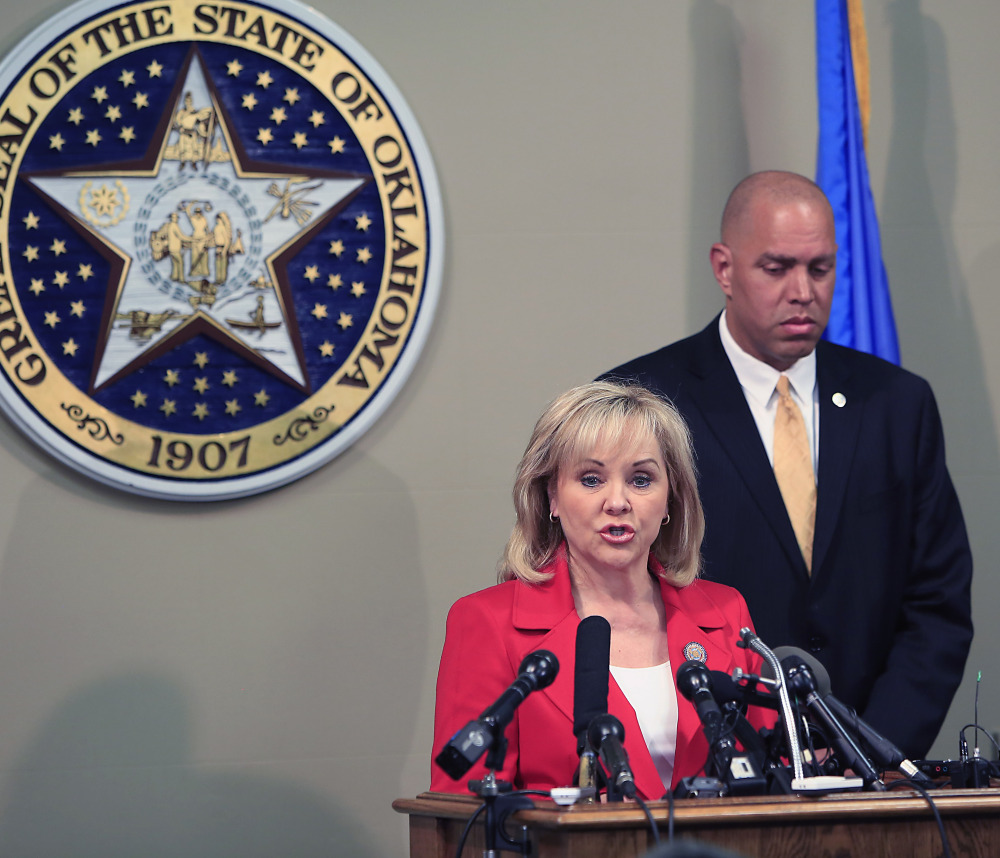 Oklahoma Gov. Mary Fallin issues a statement Wednesday on the execution of Clayton Lockett as Oklahoma Secretary of Safety and Security Michael C. Thompson listens.
