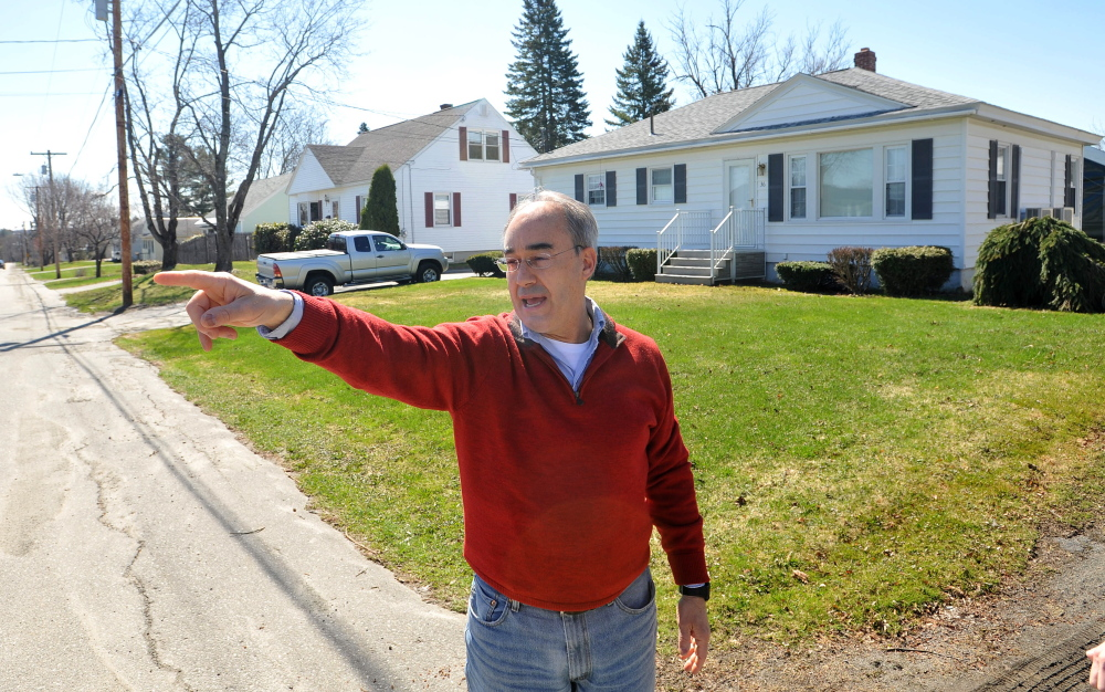 Bruce Poliquin stands in front of his childhood home on Violette Avenue in Waterville on Friday.
