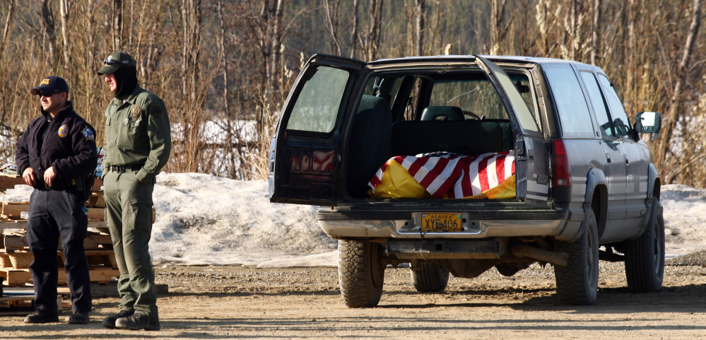 "The bodies of Alaska State Trooper Sergeant Patrick ""Scott"" Johnson and Trooper Gabriel ""Gabe"" Rich await transport to Anchorage, Alaska on Friday, at the airport in the village of Tanana, Alaska."