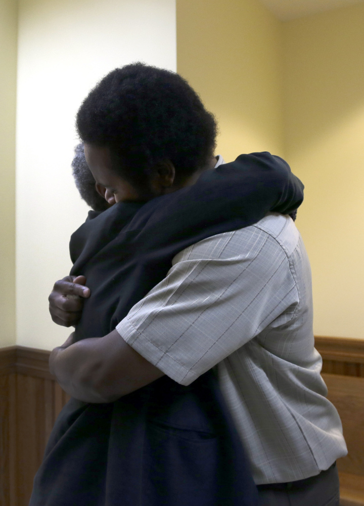 """Cornealious """"Mike"""" Anderson gets a hug from his grandmother Mary Porter after being released from custody on Monday."""