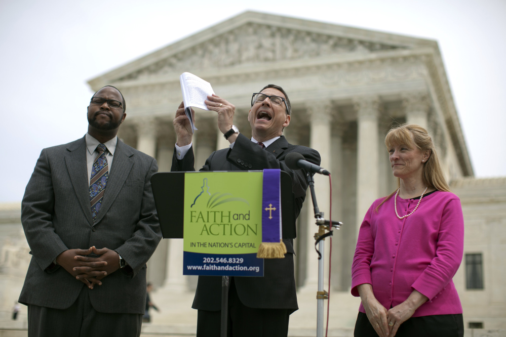The Rev. Dr. Rob Schenck of Faith and Action, center, speaks in front of the U.S. Supreme Court with Raymond Moore, left, and Patty Bills, both also of Faith and Action, during a news conference Monday in Washington, in favor of the ruling by the court's conservative majority that upheld decidedly Christian prayers at the start of local council meetings in a New York town.