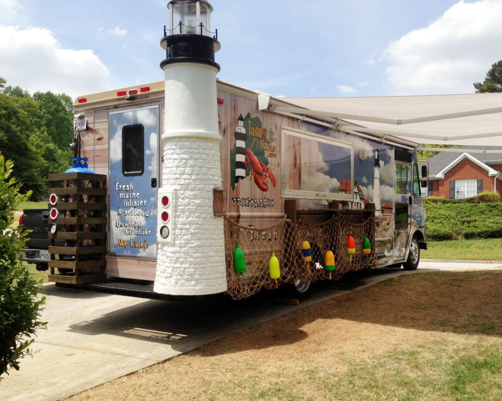 Native Mainer Fred Owen plans to debut his Maine lobster food truck business, Tasting Maine, in Atlanta this month. It is one of several food trucks around the country that serve lobster rolls and other Maine cuisine. Owen's food truck is unusual in that it has a replica of the Portland Head Light lighthouse on the back.