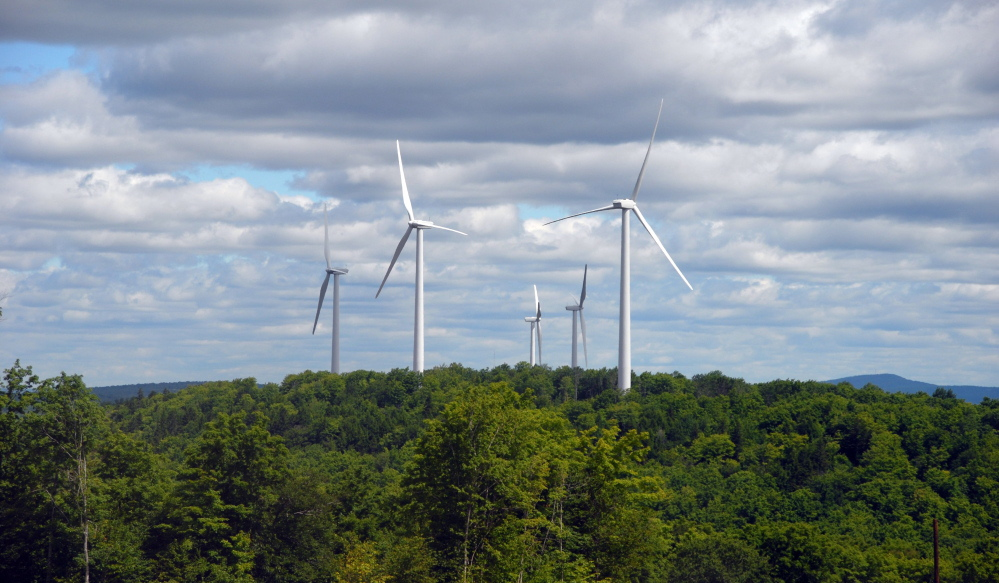 First Wind turbines spin on Stetson Mountain in Maine. The state public advocate's office has withdrawn its opposition to a multimillion-dollar joint venture by First Wind and Emera to build wind turbines across Maine and the Northeast.