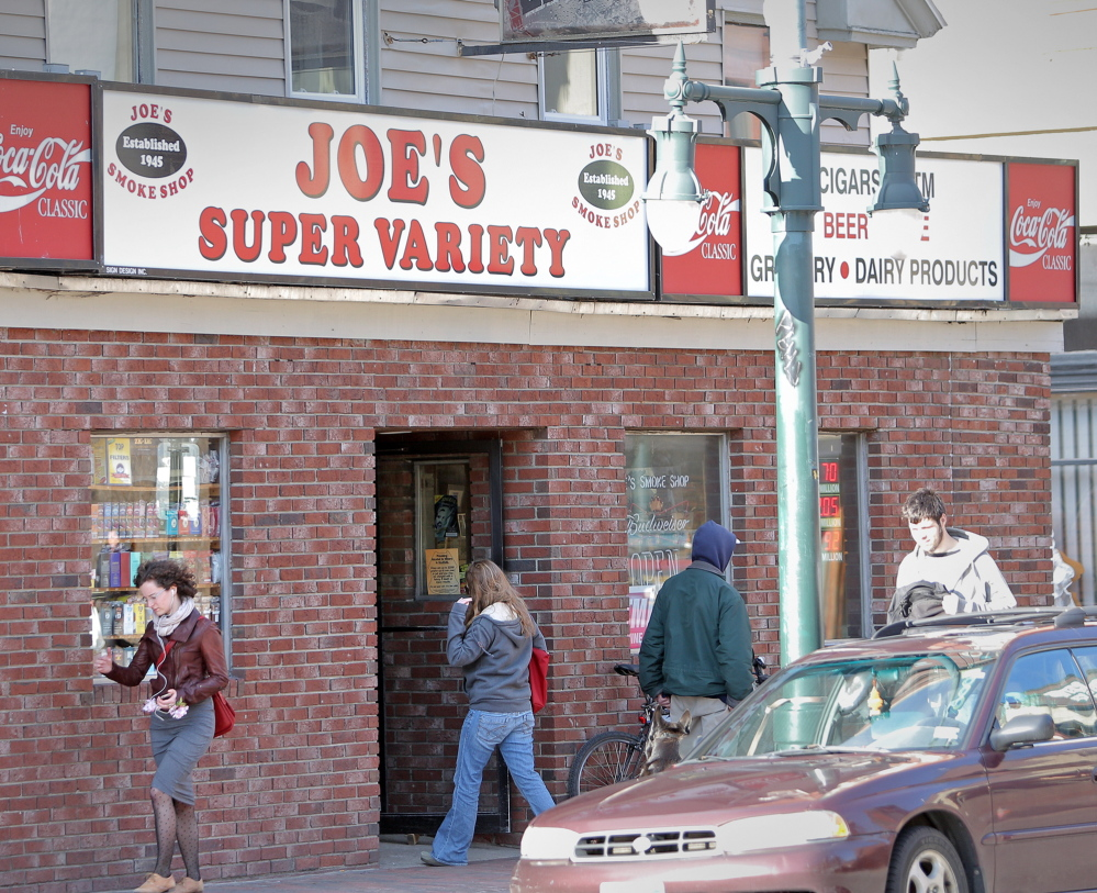 Customers enter and exit Joe's Super Variety on Congress Street in Portland, formerly Joe's Smoke Shop. One reason for the new name: The old one got caught up in welfare reform politics and publicity about the use of welfare benefit cards where tobacco is sold.