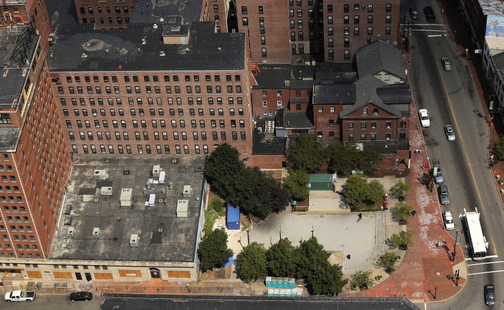 A portion of Congress Square Plaza, bordered by buildings on two sides, has been sold to a developer, but the deal could be stalled or negated if a referendum pushed by foes of the deal is approved by voters in June.