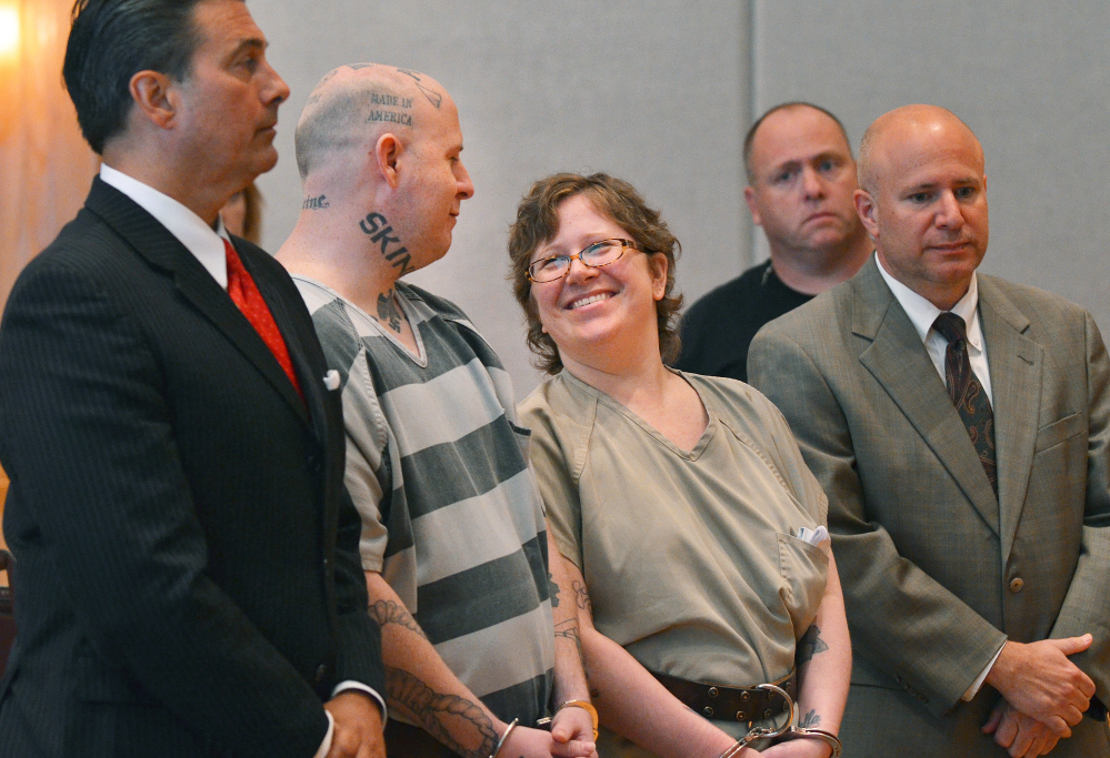 Jeremy Lee Moody and his wife Christine smile at each other before they were both sentenced to life in prison on Tuesday, May 6, 2014, in Union, S.C. Authorities say Jeremy and Christine Moody killed 59-year-old Charles Parker and his 51-year-old wife Gretchen Parker last July, stabbing and shooting them. Investigators say the Moodys are members of a loosely organized online white supremacist group called Crew 41 and decided to kill Parker because he had taken advantage of a disabled woman. (AP Photo/Spartanburg Herald-Journal, Tim Kimzey)