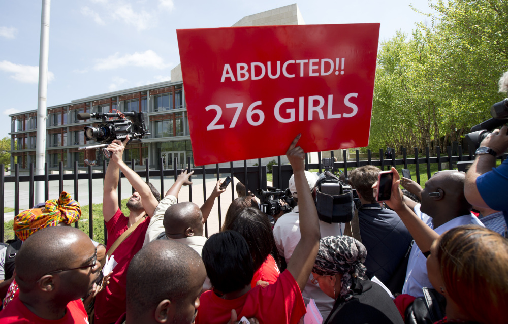 Demonstrators crowd the gate of the Nigerian embassy in Washington, D.C., Tuesday, protesting the kidnapping of nearly 300 schoolgirls, abducted from a school in a remote region of Nigeria three weeks ago.