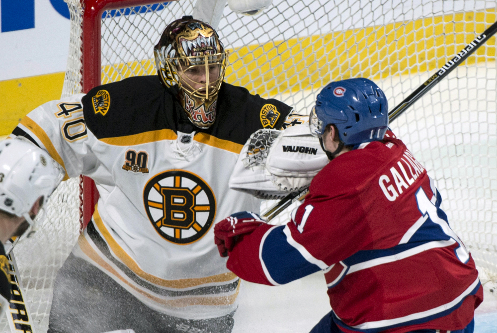 Boston Bruins goalie Tuukka Rask fends off Montreal Canadiens' Brendan Gallagher, right, during second period of Game 3 of an NHL hockey Stanley Cup playoff series, Tuesday, May 6, 2014, in Montreal.