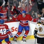 Montreal Canadiens right wing Dale Weise (22) celebrates his goal with teammate center Daniel Briere (48) as Boston Bruins defenseman Andrej Meszaros (41) looks on during the second period of Game 3 of an NHL hockey Stanley Cup playoff series, Tuesday, May 6, 2014, in Montreal.