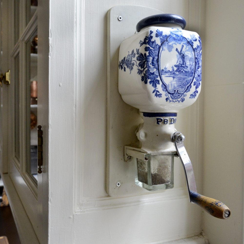 A ceramic coffee grinder affixed to a cupboard is one of the touches tour takers will see when they visit this kitchen on Portland's Western Promenade this weekend.