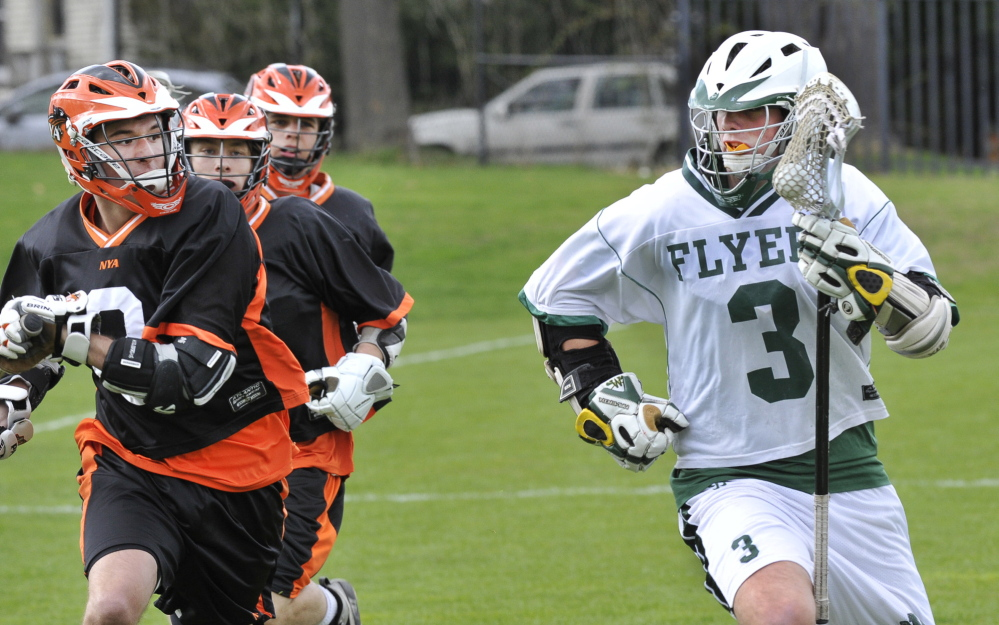Henry Cleaves, who scored three goals for Waynflete, is pursued by an NYA group that includes Colton Ackerman, left. The Flyers improved to 3-1 and dropped the Panthers to 0-4.