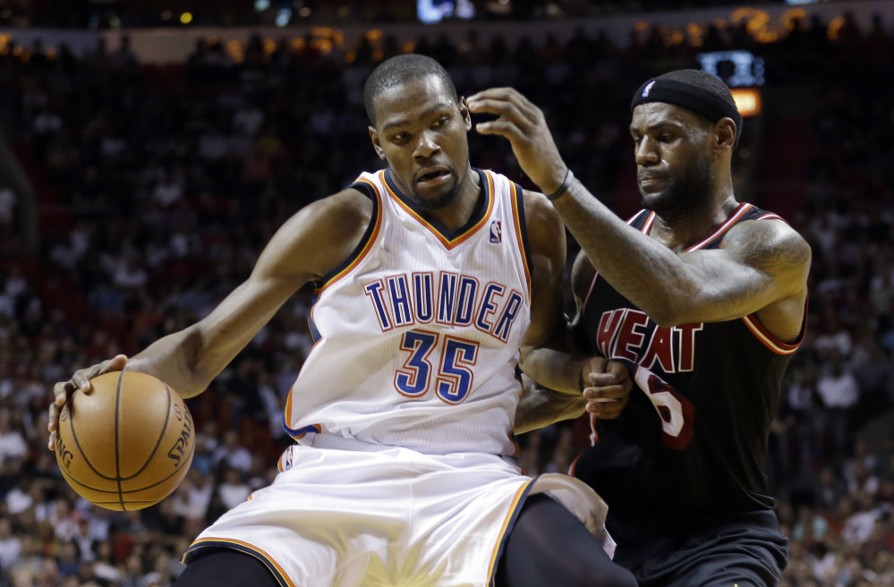In this Jan. 29, 2014 file photo, Miami Heat small forward LeBron James (6) puts pressure on Oklahoma City Thunder small forward Kevin Durant (35) during the fourth period of an NBA basketball game in Miami.