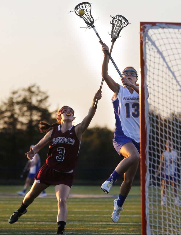 Julia Spugnardi of Falmouth attempts to receive a pass while defended by Lizzy Martin of Freeport at Falmouth High.