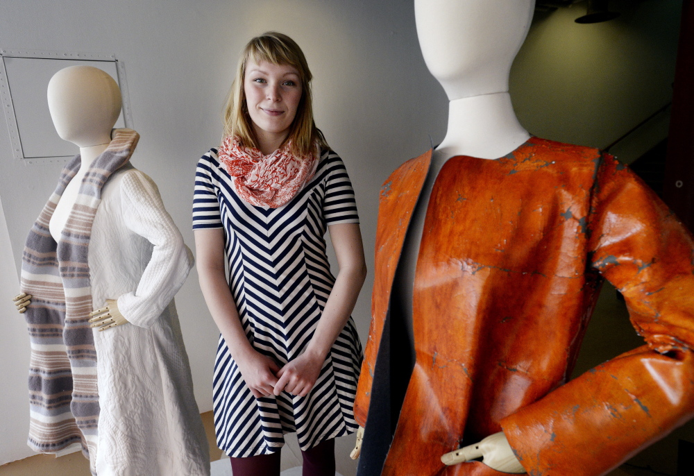 Rose Allard in the display window with some of her work at the Maine College of Art. Allard, who holds the distinction of being the first graduate of MECA's textile and fashion design program, credits her Finnish grandmother for the inspiration behind many of her creations.