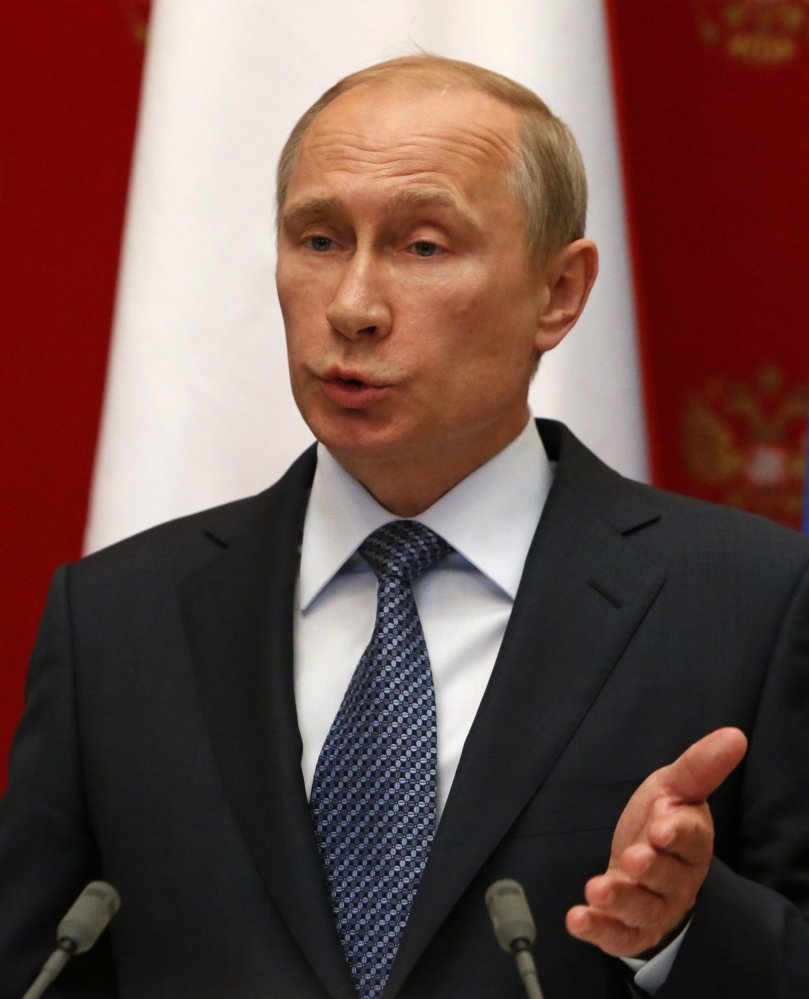 Russian President Vladimir Putin is seen at a news conference in the Kremlin in Moscow on Wednesday.
