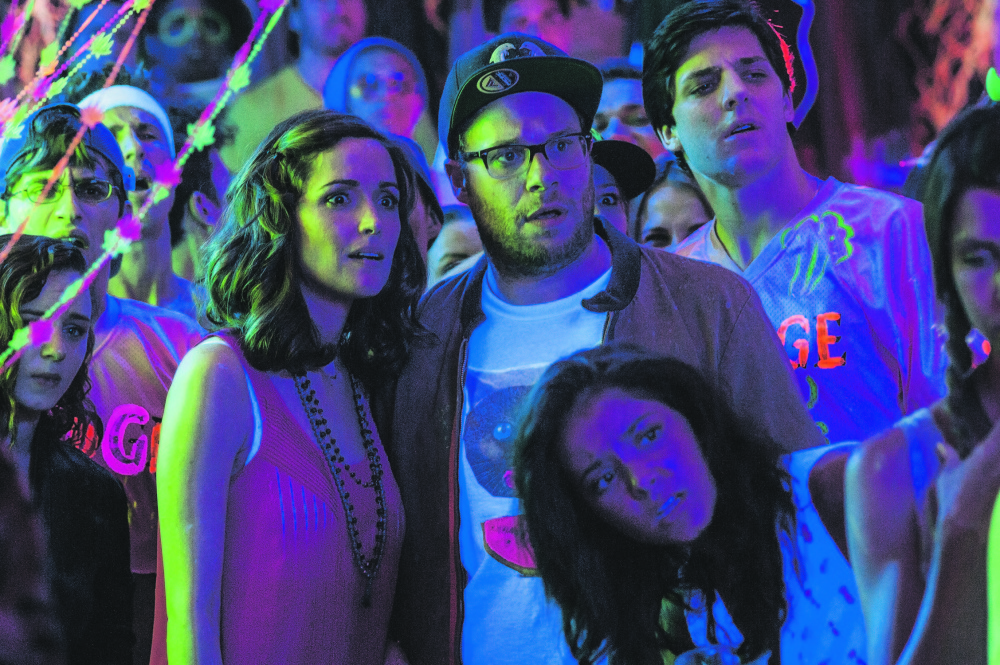 "Rose Byrne, left, and Seth Rogen are former partyers confronting their waning coolness in ""Neighbors."""