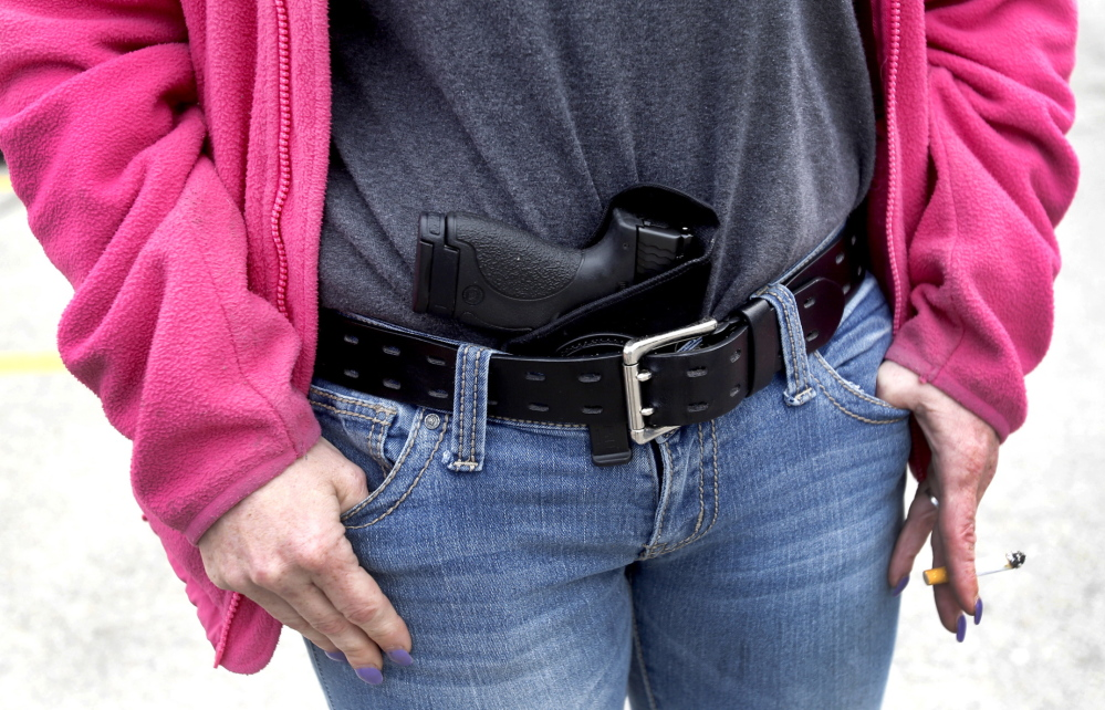 A woman carries 9 mm Smith & Wesson pistol in her waist band. Even lawmakers who support bills to permit guns in more places are mostly against allowing them in their own workplaces.