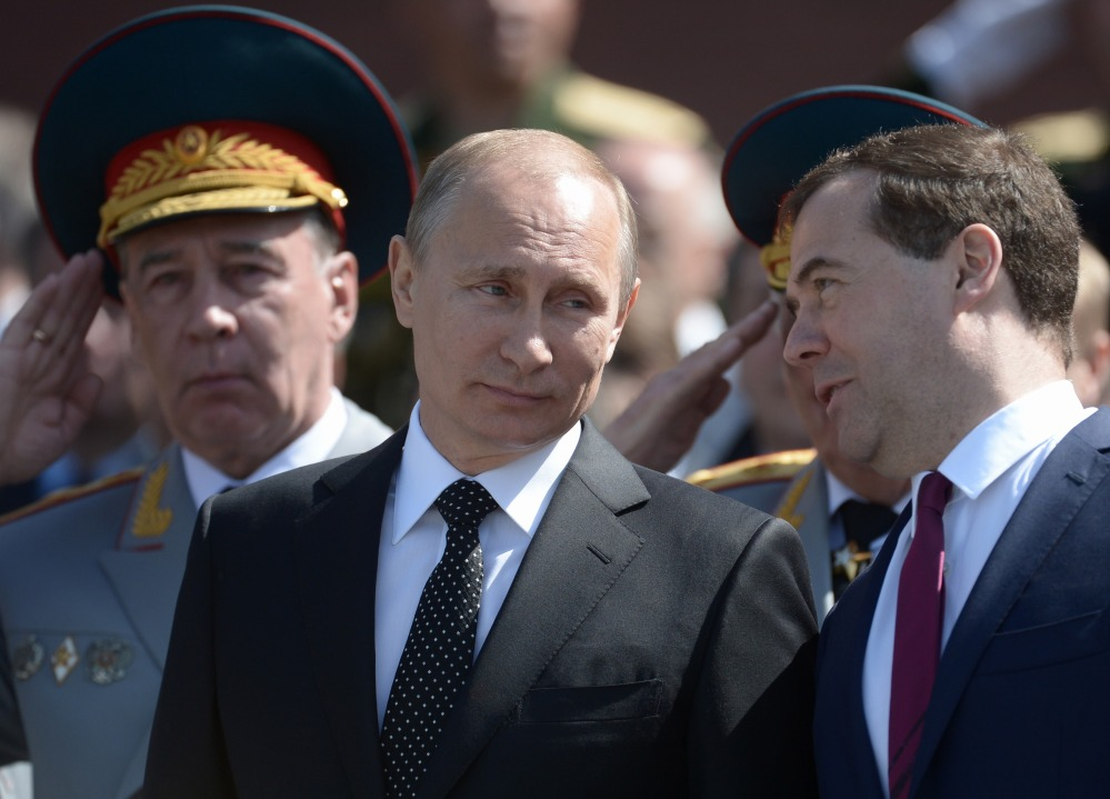 Russian President Vladimir Putin attends a wreath-laying ceremony Thursday in Moscow on the eve of Victory Day marking Nazi Germany's surrender in World War II.