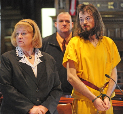 """Leroy H. Smith III stands during his first court appearance Thursday with this court-appointed attorney Pam Ames. Smith told investigators he """"filleted"""" his father because he sexually assaulted him his whole life."""