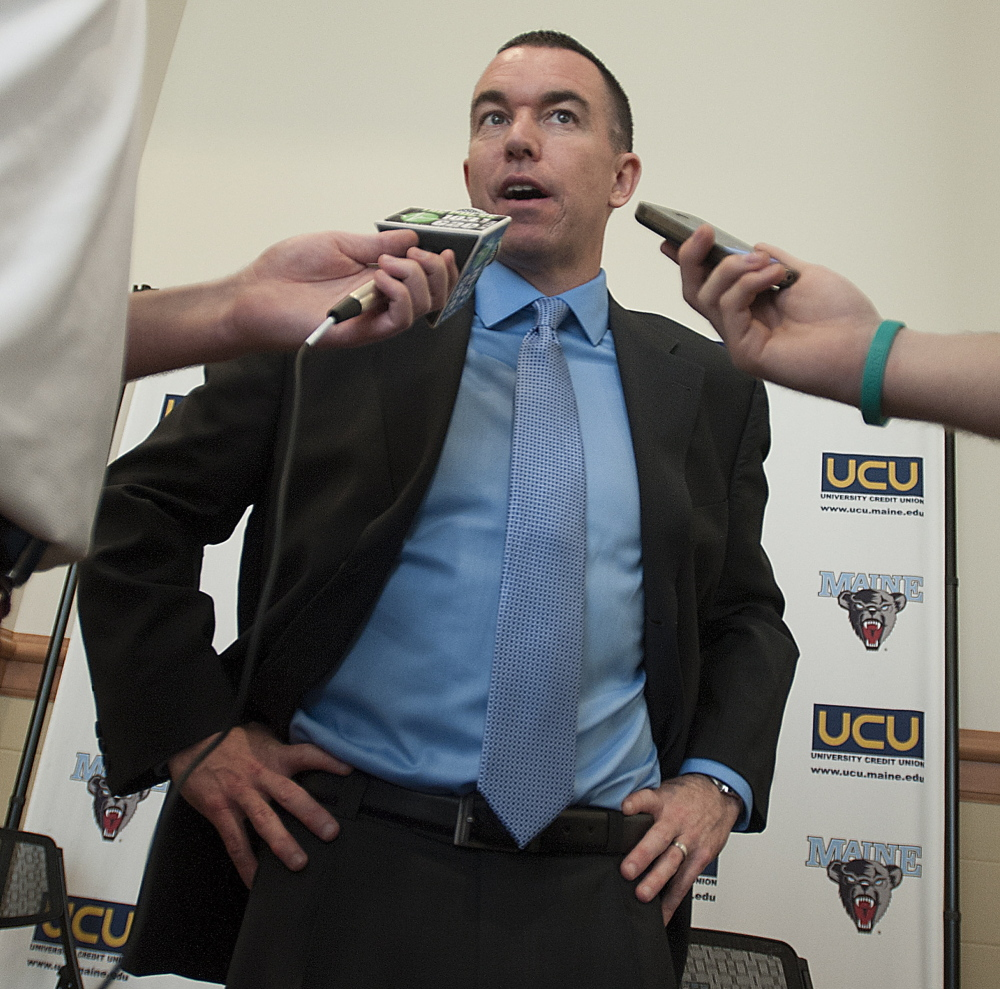 Bob Walsh looks dressed for success while being introduced at Bangor's Cross Center as UMaine's new men's basketball coach, but turning around the woeful Black Bears will be no slam-dunk for the 42-year-old.