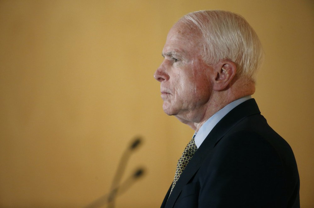 Sen. John McCain listens to complaints from veterans during a forum with veterans Friday in Phoenix.