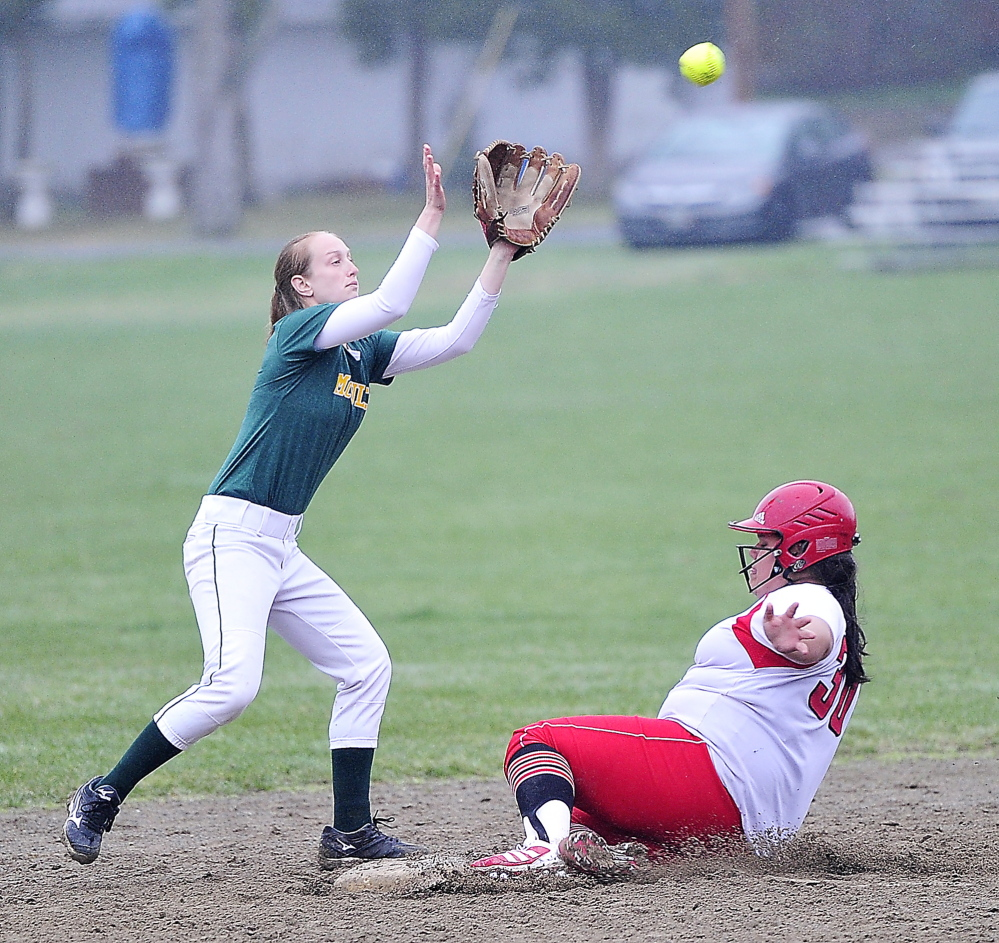 Kaitlin Bouchard of South Portland slides safely into second base Friday as Taylor Whaley of McAuley waits for a high throw from home plate during their SMAA softball game in Portland. South Portland won 9-7 on Olivia Indorf's three-run homer in the seventh inning.