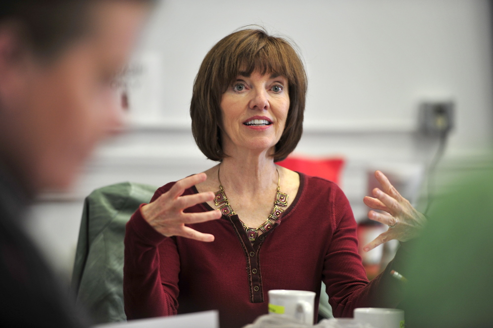 """Monica Wood works with actors at Portland Stage Company during a reading of the script for her play """"Papermaker."""" Portland Stage produced a working version of """"Papermaker"""" for its Little Festival of the Unexpected and will premiere the finished piece next season."""