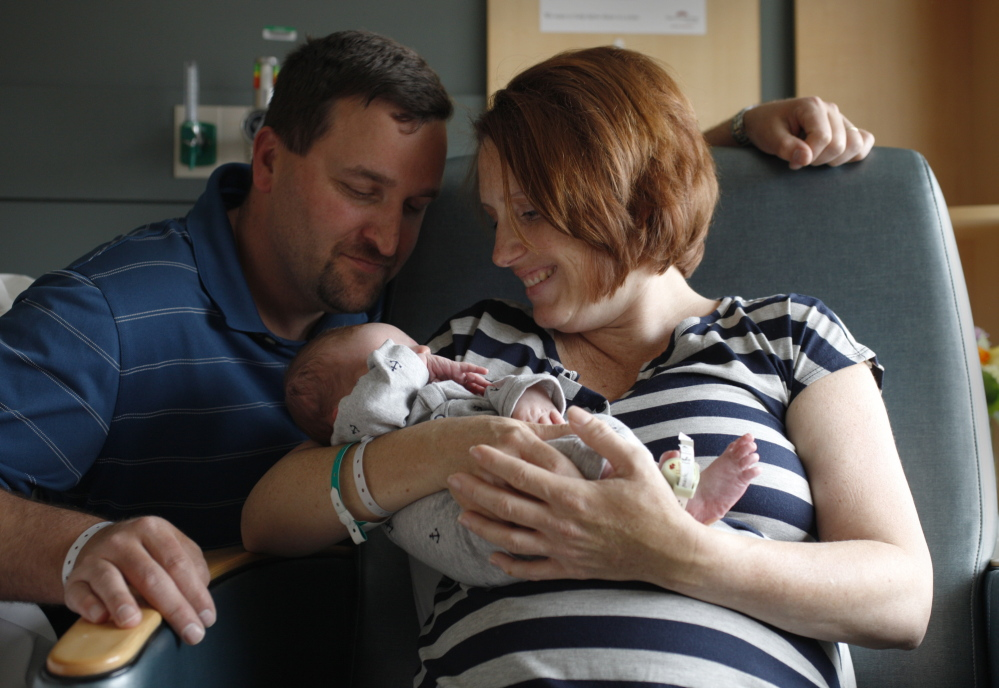 Aaron Thomas Gallivan, seen here with his parents Sean and Ondrea Gallivan, was born Wednesday, weighing 8 pounds, 6 ounces. The Gallivans married in 2010, when they were well into their 30s. They tried fertility treatments for a while, but Ondrea became pregnant during a time when they had paused the treatments.