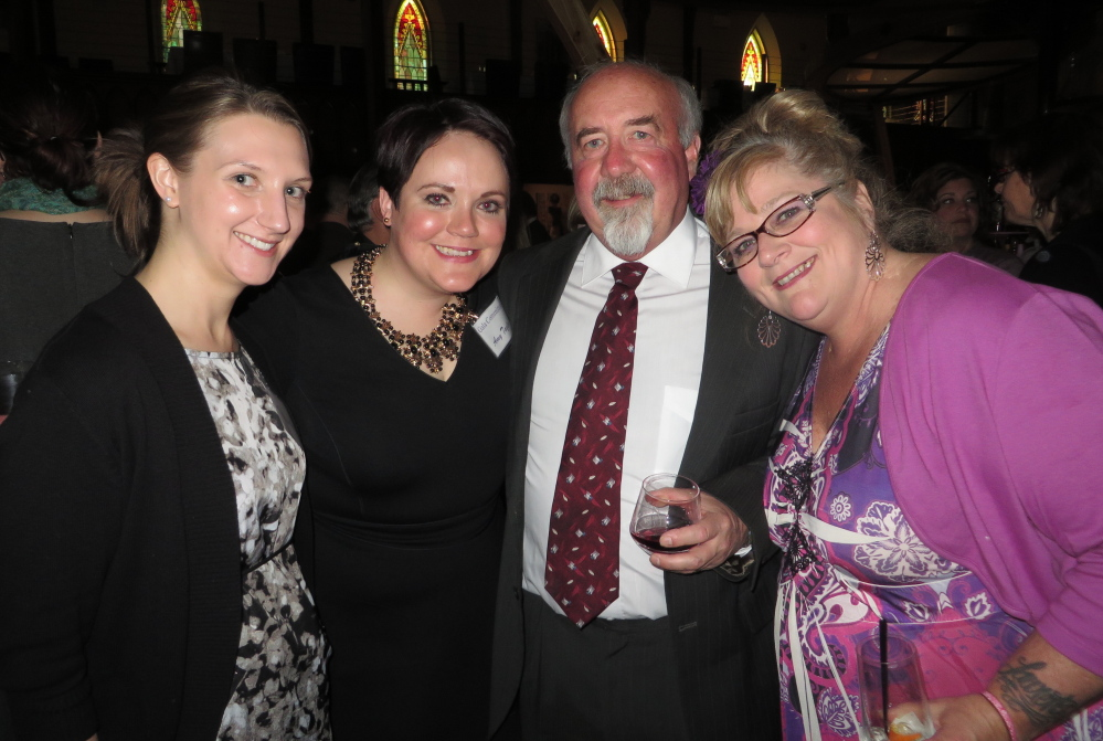 Volunteer Jessica Watson, left, board member Amy Taylor, Craig Aderman of Freeport and Michelle Locke of Brunswick support the work of Family Crisis Services at a gala at Grace restaurant in Portland.