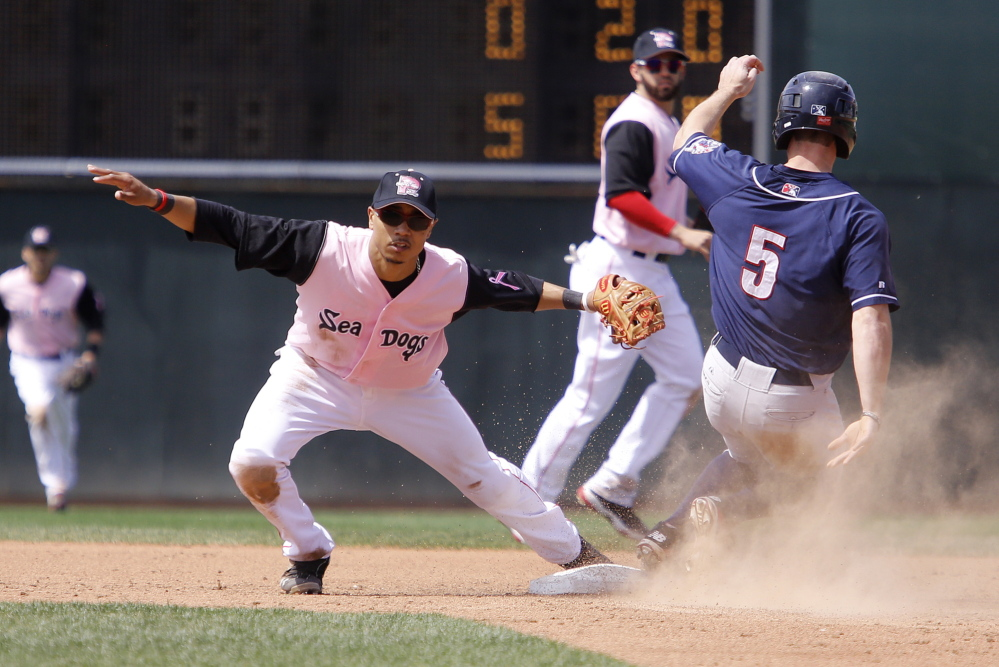 Portland's Mookie Betts can't make the tag as Manchester's Jon Berti steals second base during the third inning of Sunday's game at Hadlock Field.