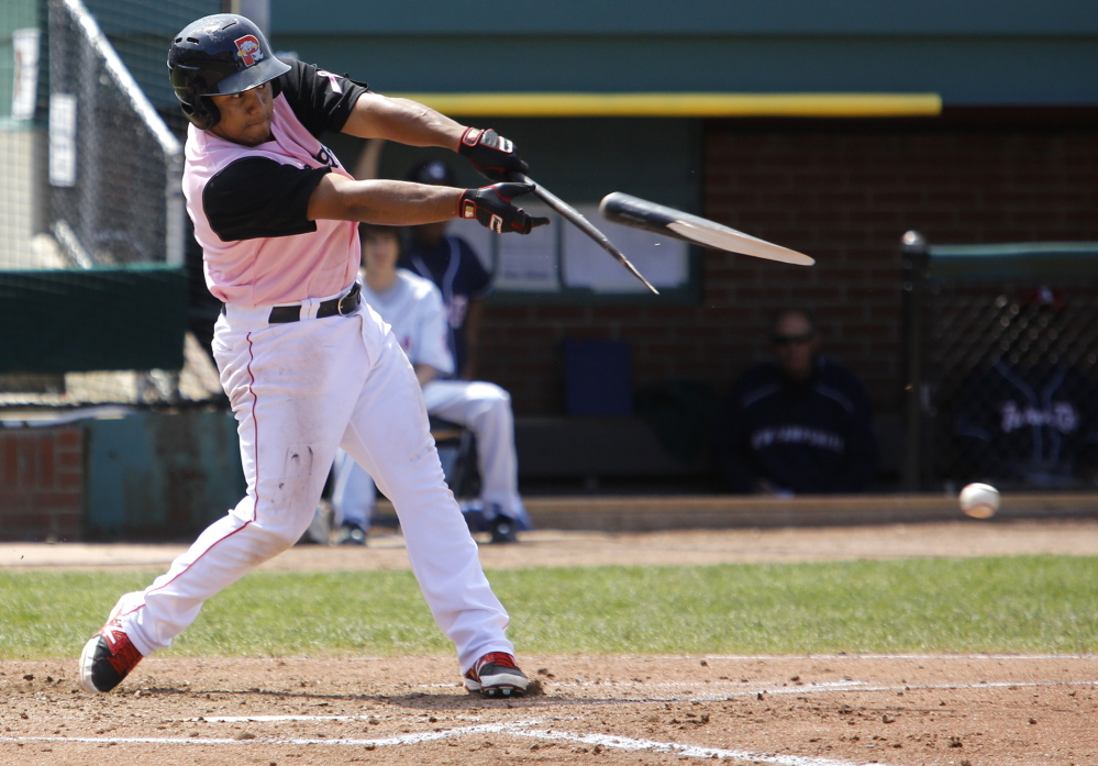 Heiker Meneses of the Sea Dogs breaks his bat early in Sunday's game against New Hampshire. Meneses capped a four-run ninth inning with an RBI single that gave the Sea Dogs a 13-12 victory.