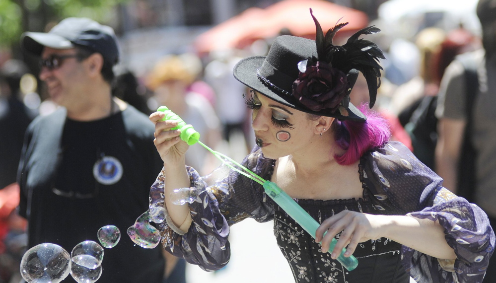 Miss Polly, an Old Port Festival street performer in 2012, and other characters will have three days to play this year as the annual party kicks off June 6 and runs through June 8.