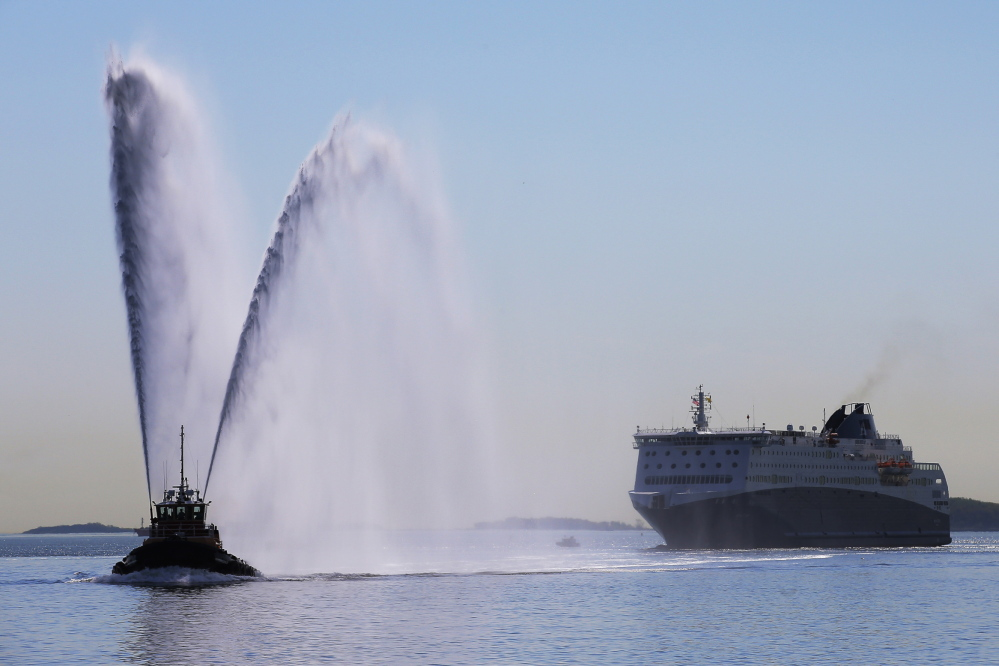 The Nova Star cruise ferry is escorted into port in Boston for a christening ceremony Monday.