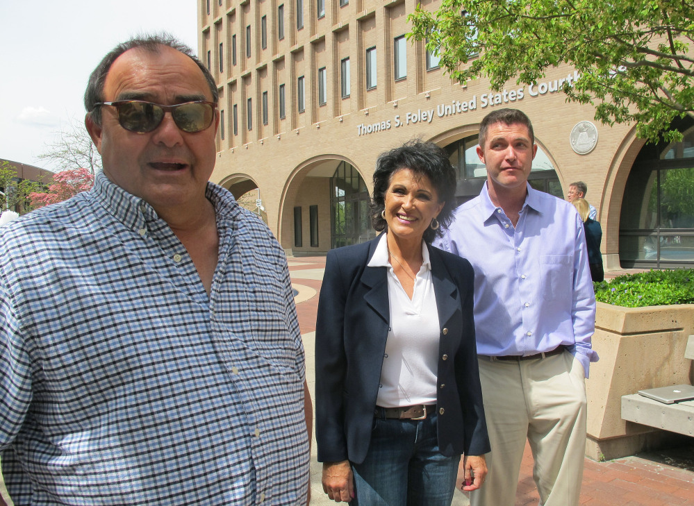 Larry Harvey, left, Rhonda Firestack-Harvey, and Rolland Gregg stand in the plaza in front of the federal courthouse in Spokane, Wash. The three are charged with growing marijuana at a remote farm near Kettle Falls, Wash., and each faces mandatory minimum sentences of at least 10 years in prison after they were caught growing about 70 pot plants on their rural, mountainous property.