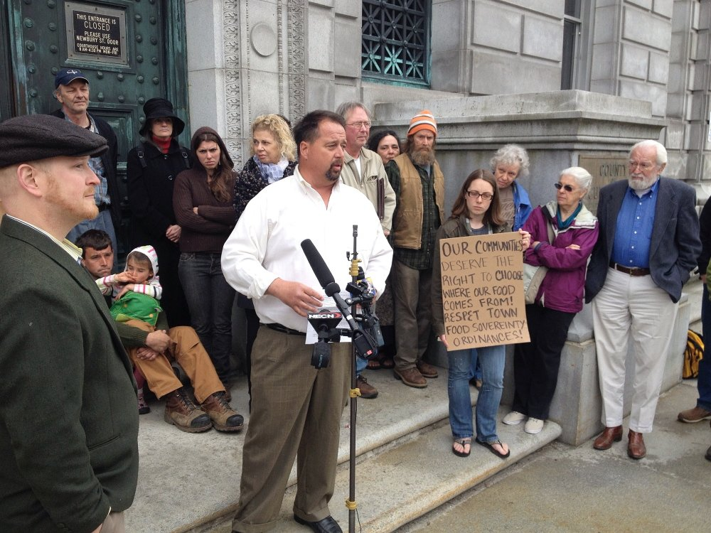 Surrounded by supporters on the steps of the Cumberland County Courthouse in Portland on Tuesday, Dan Brown of Blue Hill speaks to the media about his case before the Maine Supreme Judicial Court.