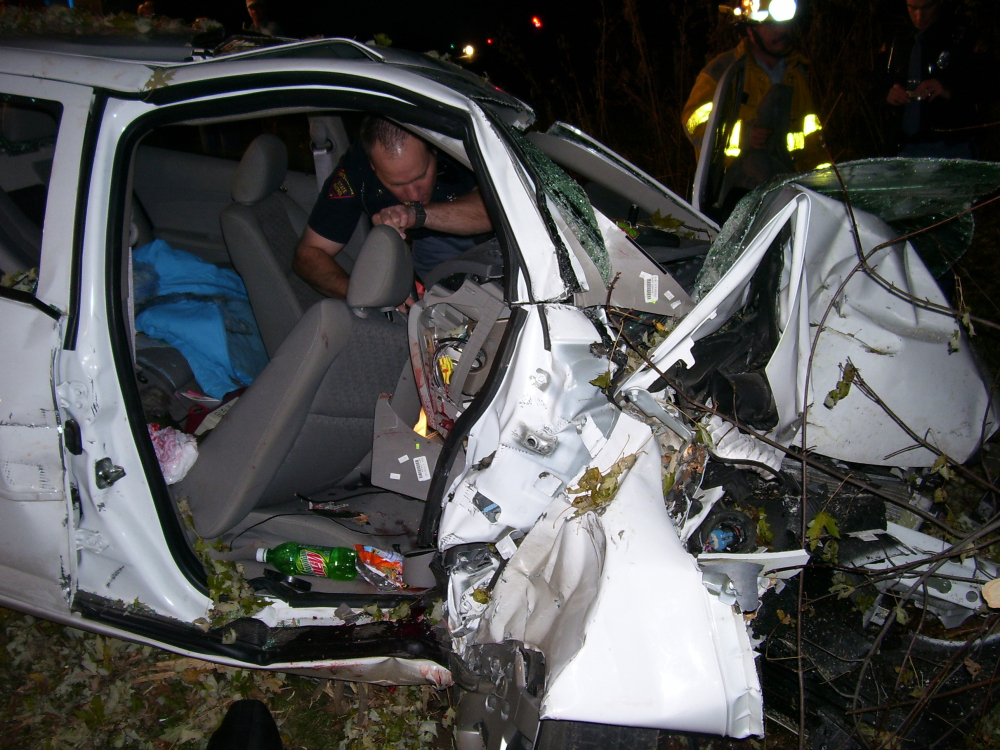 """Police investigate the wreckage of a 2005 Chevrolet Cobalt that crashed in Wisconsin, killing Natasha Weigel, 18, and Amy Lynn Rademaker, 15, and injuring the 17-year-old driver, Megan Ungar-Kerns. The vehicle's ignition was found in the """"accessory"""" position and the air bags didn't deploy."""