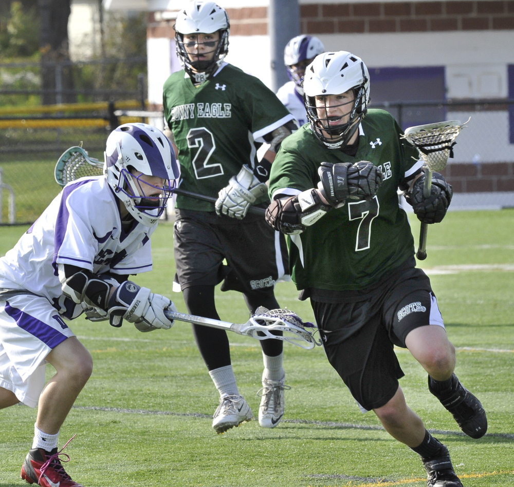 Zack Gryskwicz of Bonny Eagle looks for a way to get past Isaac Santerre of Deering during their high school lacrosse game Wednesday. Deering pulled away to a 16-6 victory at Portland.