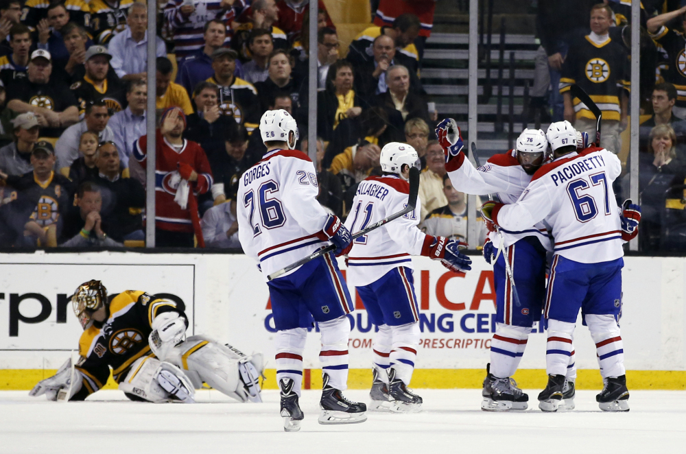 Montreal Canadiens left wing Max Pacioretty (67) celebrates his goal with defenseman P.K. Subban (76) and other teammates, against Boston Bruins goalie Tuukka Rask, left, in the second period of Game 7 of the second-round playoff series in Boston on Wednesday.