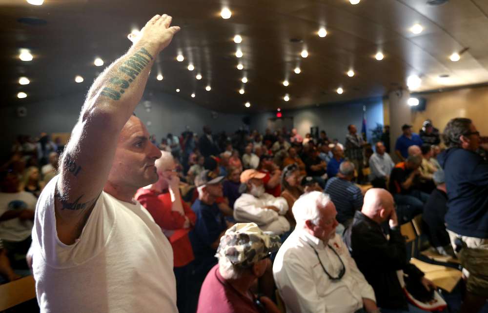 Veteran Mark Howey waits to ask a question as Sen. John McCain speaks during a forum with veterans regarding lapses in care at the Phoenix Veterans Affairs hospital, on Friday, in Phoenix.
