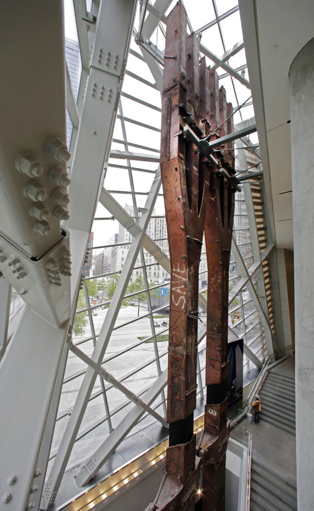 A pair of World Trade Center tridents, that once formed part of the exterior structural support of the east facade of the building, stand in the Sept. 11 Museum, in New York.