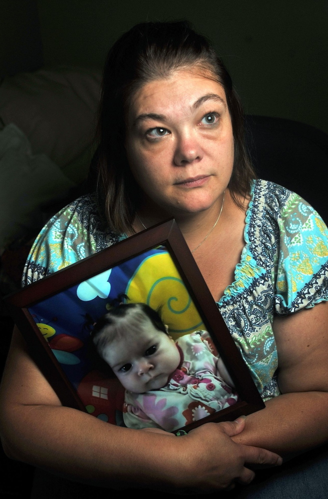 Nicole Greenaway of Clinton holds a picture of her baby, Brooklyn Foss-Greenaway, who died while in the care of a family friend in 2012.